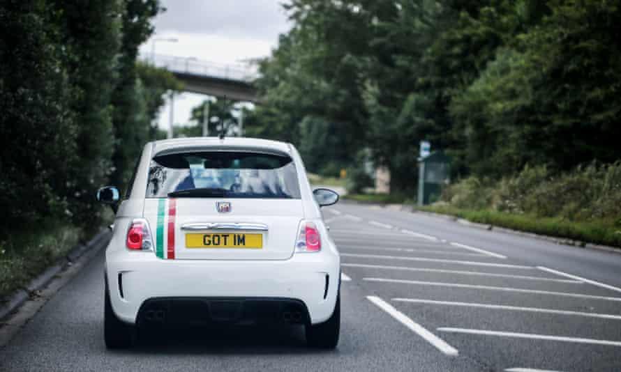 A white Fiat Abart car