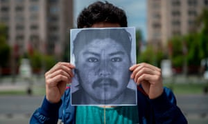 A demonstrator holds an image of Camilo Catrillanca in front of La Moneda Palace in Santiago, Chile, on 22 November.