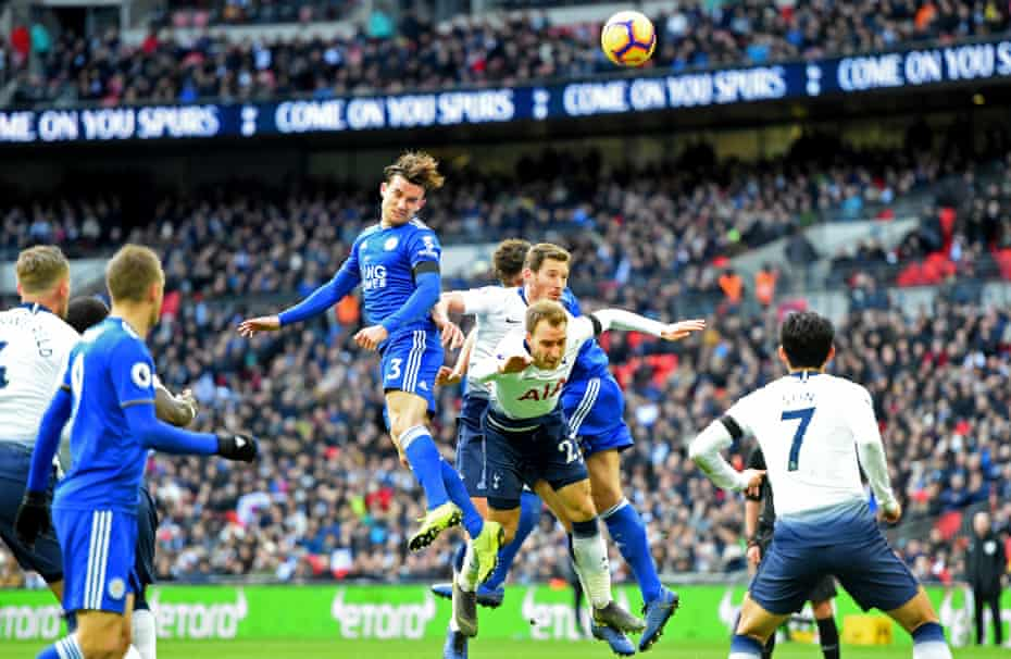 Ben Chilwell rises above the Tottenham defence.