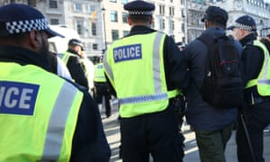 A man is led away by police during Black Lives Matter rally in Trafalgar Square, London