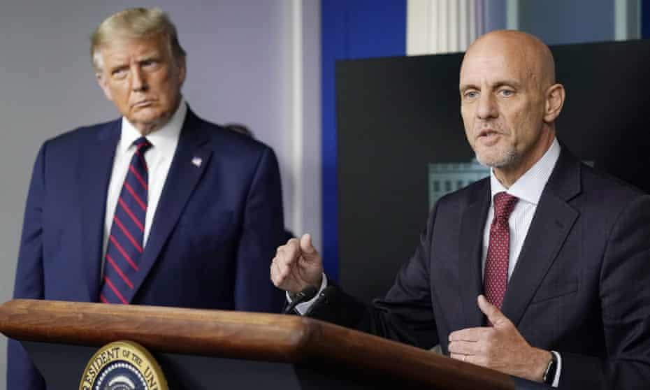 Donald Trump listens as Dr Stephen Hahn, commissioner of the FDA, speaks during a media briefing in the White House on 23 August.