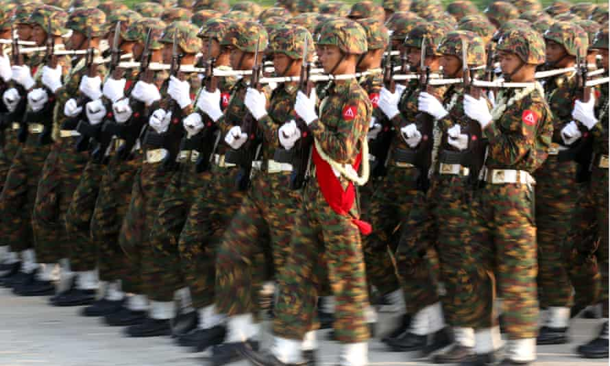 A military parade in Myanmar. Australia has offered $400,000 towards training in humanitarian assistance, disaster relief, peacekeeping and English classes to the nation's military.