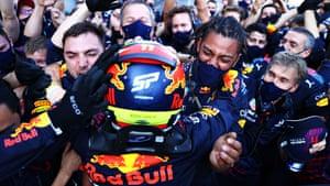 Sergio Perez celebrates with his team after an astonishing end to the Azerbaijan Grand Prix.