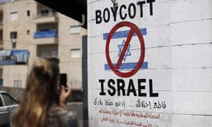 A sign on a wall in Bethlehem calling for a boycott of Israeli products from Jewish settlements