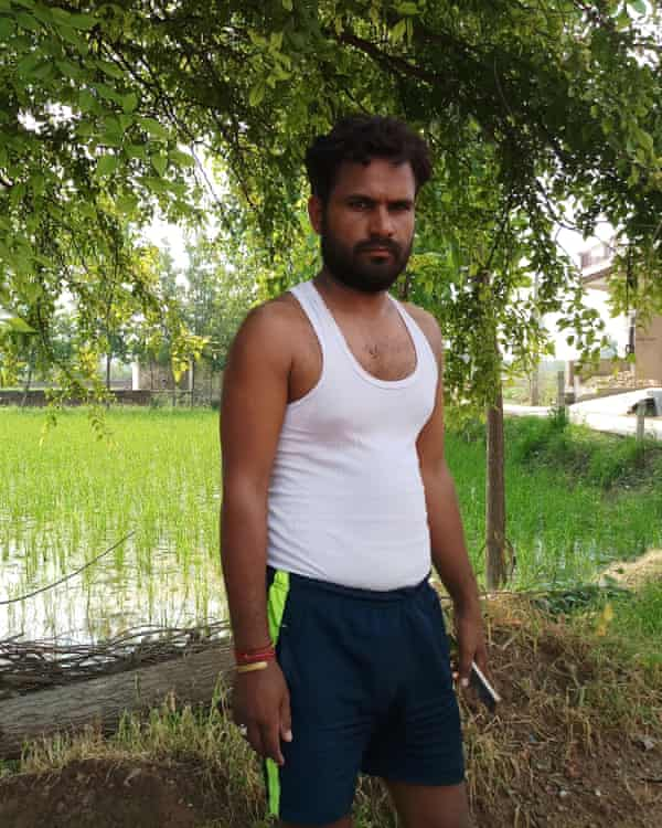 Munidev Tyagi patrols his farm at night, armed with his son's cricket bat, to protect against cows.
