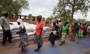 Villagers in Masvingo collect monthly rations provided by the World Food Programme