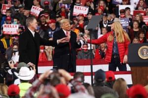 Donald Trump attends a rally in support of the senators David Perdue Kelly Loeffler.