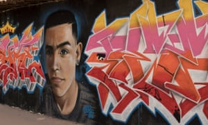 A mural of Janio Heinrich, who was shot dead by gang members.