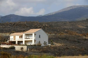 A house surrounded by devastated land following a fire in Biguglia on the island of Corsica