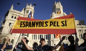"Supporters of Catalan independence hold a banner reading in Catalan "" Spaniards for Yes"" during a protest in Madrid."