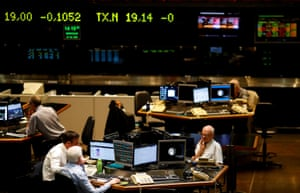 Traders on the floor of the Buenos Aires Stock Exchange, last night