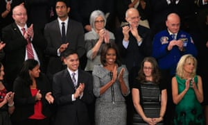 Michelle Obama leads the applause