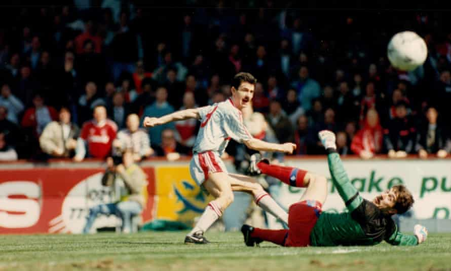 Ian Rush dinks the ball over Palace keeper Nigel Martyn to open the scoring.