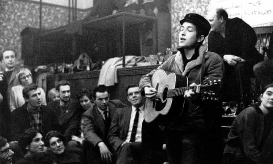 Dylan performs at the Singers Club in 1962.