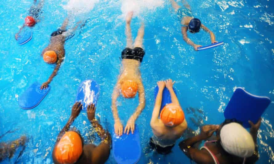 A mixed-sex school swimming lesson.