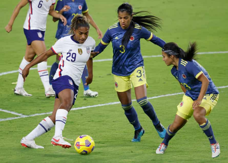 Soccer: U.S. Women's National Team International Friendly Soccer-Colombia at USAJan 18, 2021; Orlando, Florida, USA; Colombia defender Daniela Arias (3) and defender Nancy Acosta (23) defend against United States midfielder Catarina Macario (left) takes on Colombia defenders Daniela Arias and defender Nancy Acosta (right) during her USA debut on 18 January 2021.