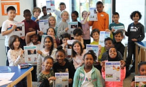 Primary school with their finished newspaper front pages at the Education Centre