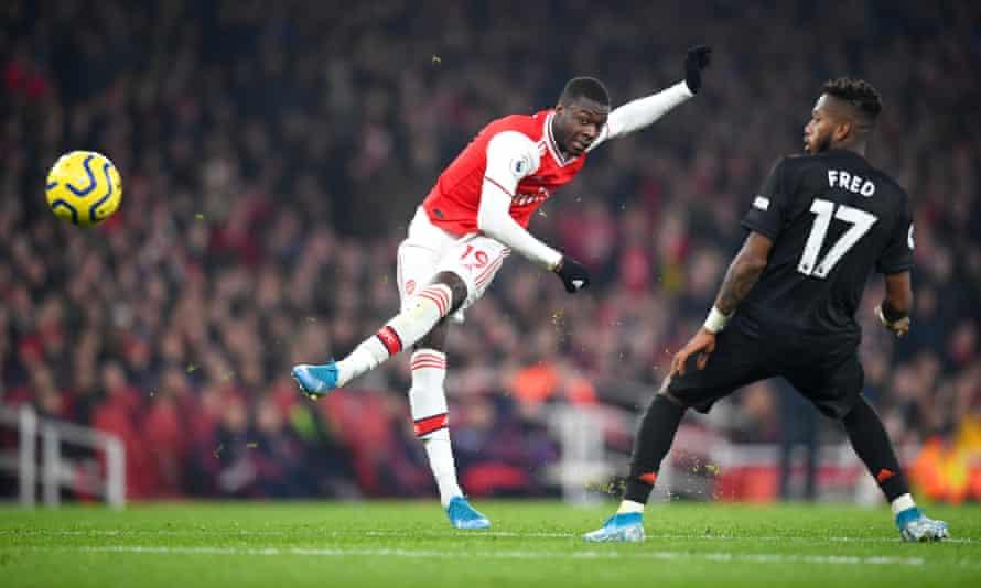 Arsenal's Nicolas Pépé shoots past Fred at the Emirates Stadium.