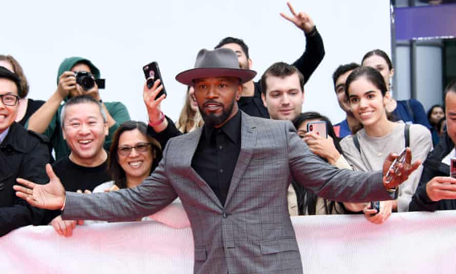 Actor Jamie Foxx poses with fans