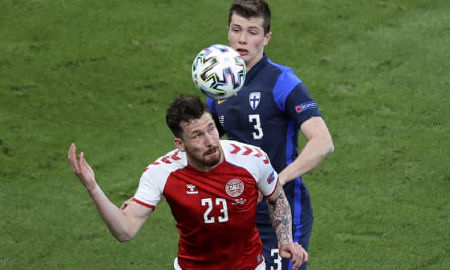 Denmark's Pierre-Emile Hojbjerg (foreground) heads the ball as Finland's Daniel O'Shaughnessy looks on. Finland won 1-0 when the match resumed.