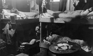 Boarders sharing a room at a hostel for Chinese people in Liverpool, May 1942.
