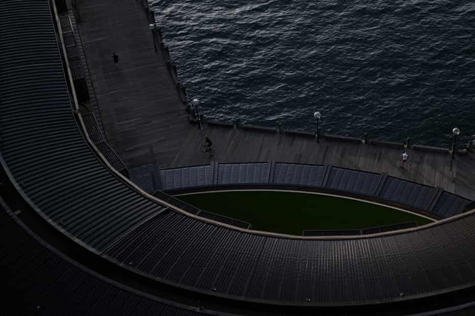 People exercise along the Sydney Harbour foreshore at sunrise in Sydney.