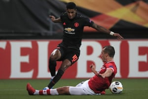 Manchester United's Marcus Rashford is tackled by Alkmaar's Stijn Wuytens.