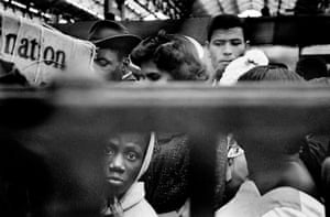 Photographs of Windrush immigrants from the West Indies arriving at Waterloo station in London via a boat train in 1962 by Howard Grey.