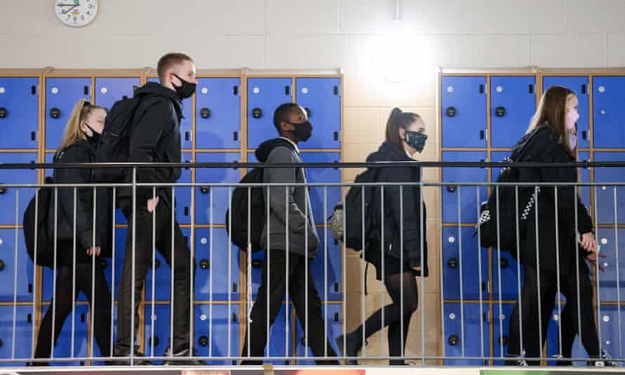 Pupils wear face coverings in school corridors.