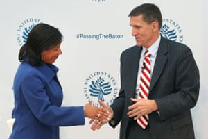 Susan Rice, shakes hands with Michael Flynn, during the 2017 Passing The Baton conference at the United States Institute of Peace.