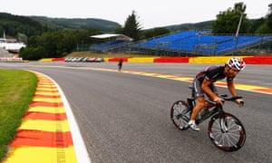 Mark Webber rides his bicycle around the Spa motor racing circuit in Belgium.