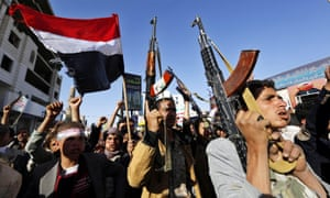Houthi supporters shout anti-Saudi slogans during a rally in Sana'a