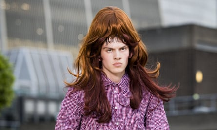 A model sports a wig at the Martine Rose show, SS2019, London fashion week men's.