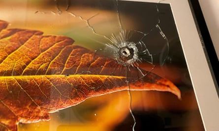 A bullet hole is seen in a framed photograph hanging on a wall following a shooting that happened at a neighbouring unit, in Toronto, Canada, on Tuesday.