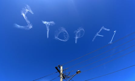The words 'Stop F1' are seen over the Sydney sky on Wednesday.