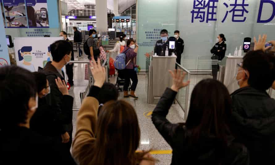 people waving goodbye at Hong Kong airport