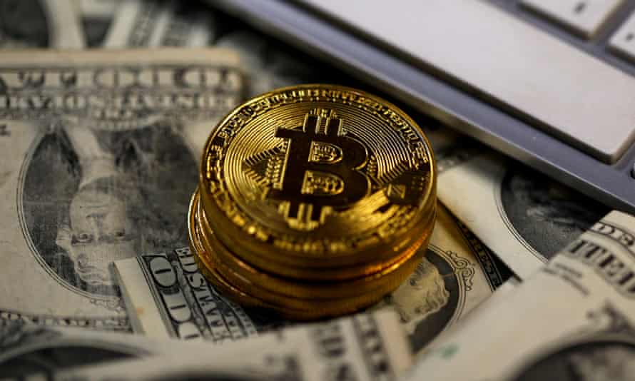 Bitcoins placed on dollar banknotes