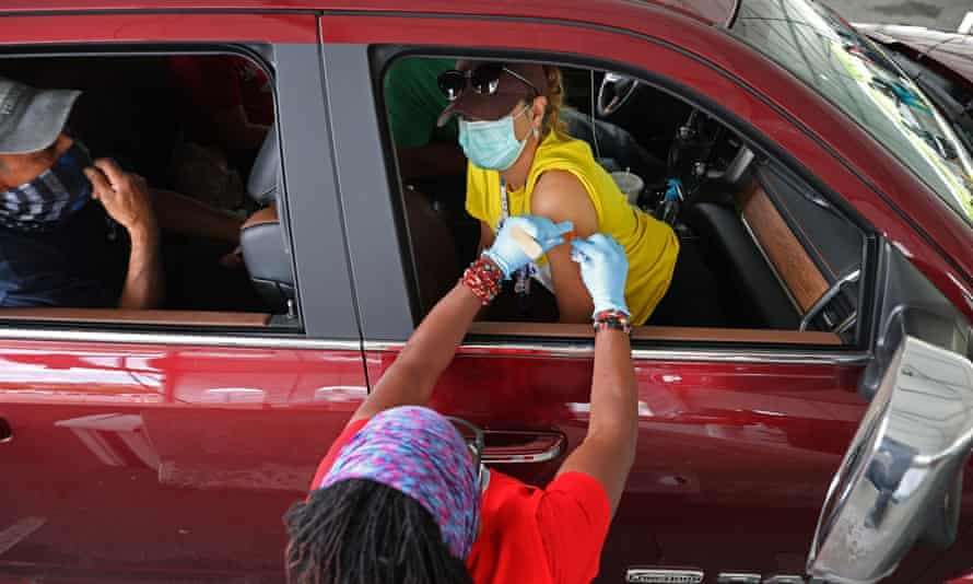 A woman receives a vaccine in Aberdeen, Maryland. The state reported that all of those who died of Covid there in June had not been vaccinated.