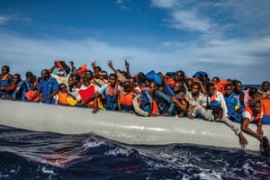 109 African refugees being rescued between Italy and Libya, October 2014