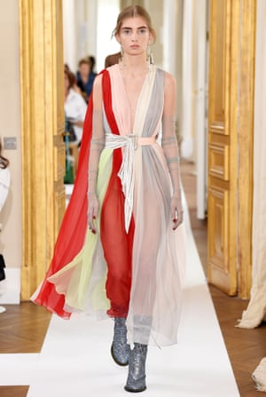 Leonie Pleuse in a belted chiffon gown at Schiaparelli.