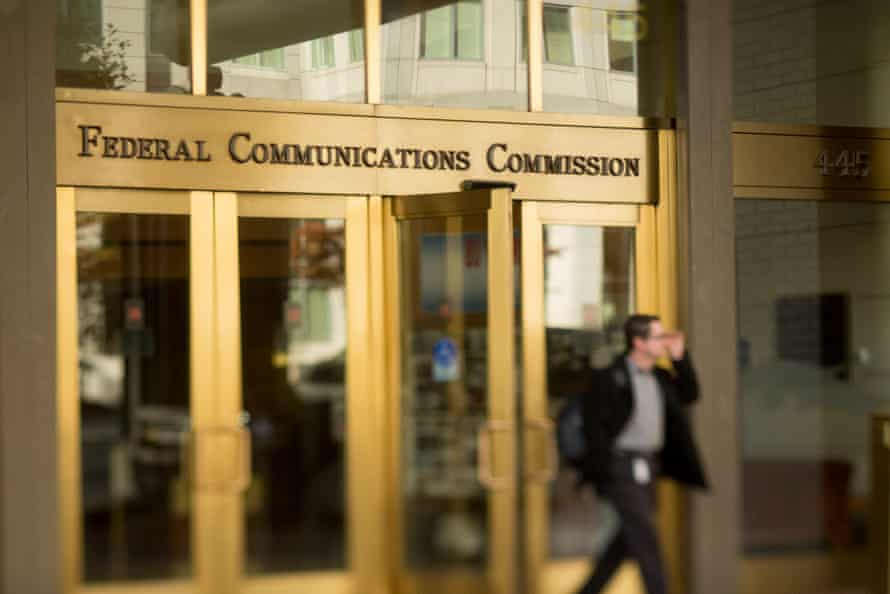 A man walks out of the Federal Communications Commission (FCC) headquarters in this photo taken with a tilt-shift lens in Washington, D.C., U.S