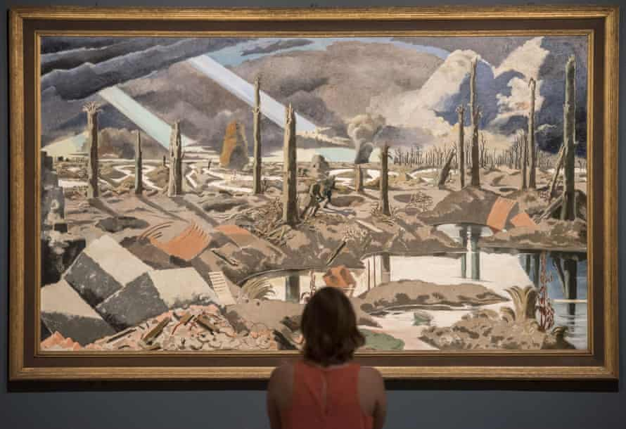 A visitor to Tate Britain's Paul Nash retrospective in front of his painting The Menin Road, 1918