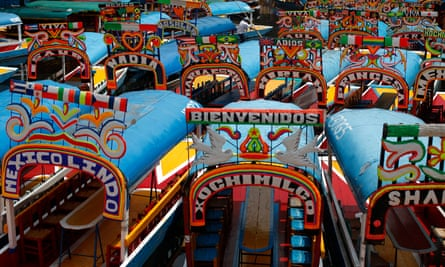 Trajinera boats parked in one of the canals of Xochimilco.