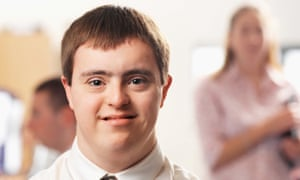 portrait of a man with Down's syndrome working in an office