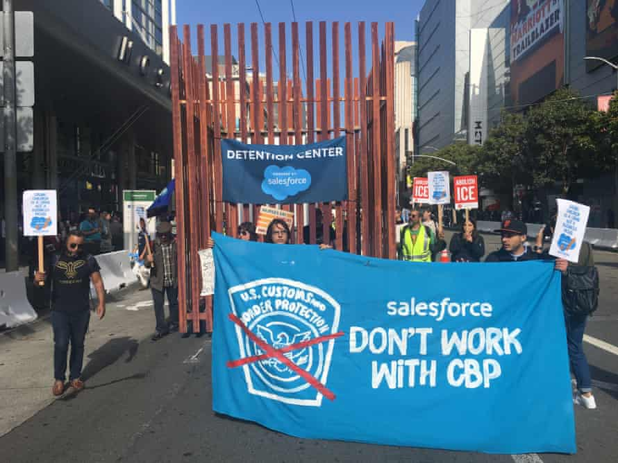 Protesters in San Francisco carried a cage to protest Salesforce's contract with CBP.
