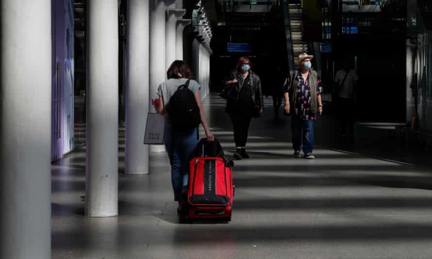 Passengers at St Pancras International station in London on Thursday