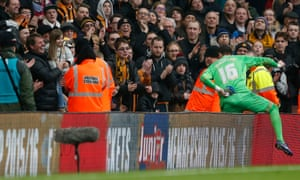 Hull City's Eldin Jakupovic climbs over the advertising boards to celebrate with his daughter.