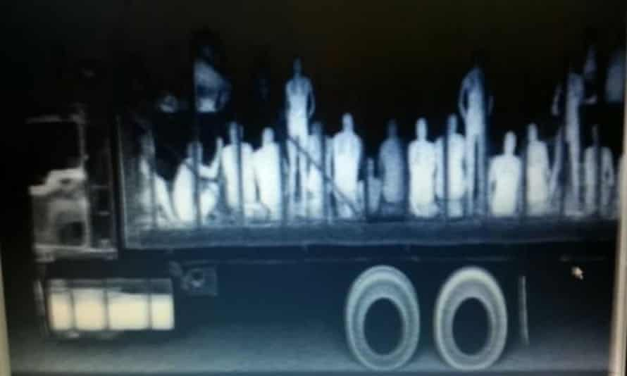 Immigrants from Central America, Nepal and Bangladesh are seen in a trailer truck after being detected by police X-ray equipment in Mexico.