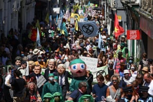 Protestors march during an Extinction Rebellion demonstration through the streets of Falmouth.