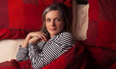 Kate Edgley in bed looking round at the camera